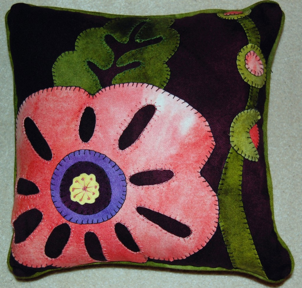 Hubba Hubba Hollyhock wool pillow. Kit by Wooly Lady. Wool, hand appliqued, machine stitched to form pillow. Completed Feb 2014, Jackson, WI.