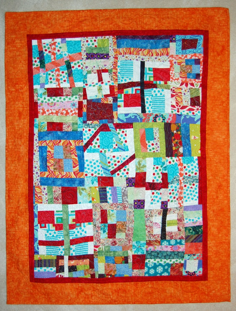 """Sandy's Scraps"" 45.5""x 34.5"". Commercial Fabrics and batiks. Machine Quilted. Completed December 31, 2013 in Jackson, WI."